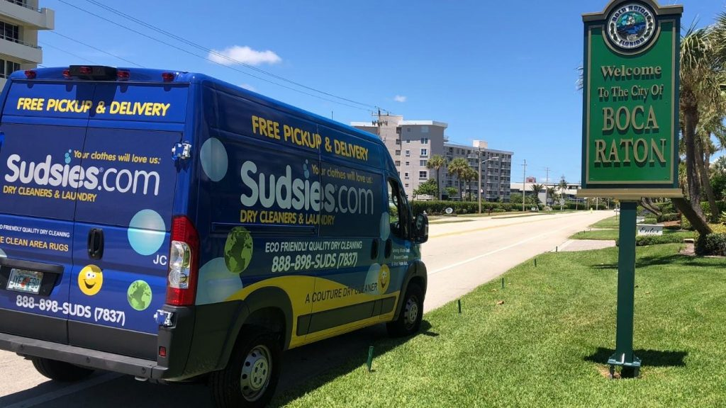 """Sudsies Van parked next to sign reading """"Welcome to the City of Boca Raton"""""""